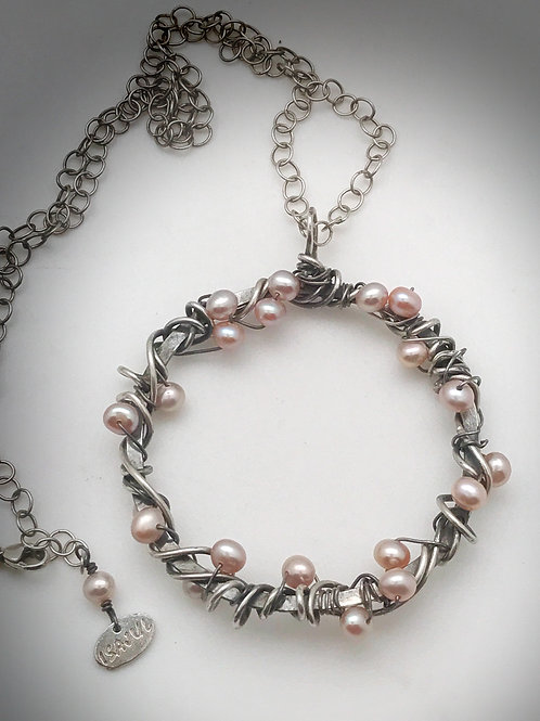 2inch circle of pale pink freshwater pearls and sterling silver pendant with 18