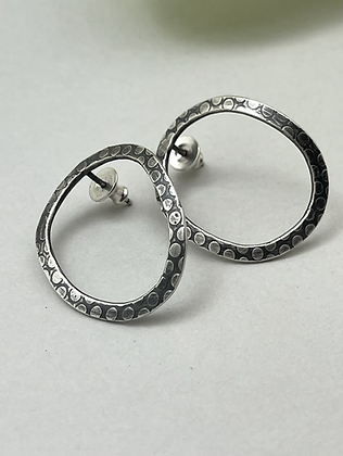 Forward Facing Oval Sterling Hoops with dot pattern. Earrings are post style and have been slightly darkened.