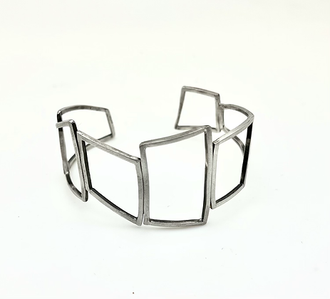 sterling cuff bracelet made with organic shapes in squares and rectangles