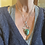 Large chrysocolla Pendant with handmade sterling silver chain on a woman