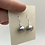 Large burnished sterling silver balls dangling from a sterling silver earlier