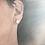 flattened ball earrings in sterling silver. approx 3/8 inch in diameter. pictured on model