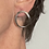 Forward Facing Oval Sterling Hoops with dot pattern. Earrings are post style and have been slightly darkened. shown on model