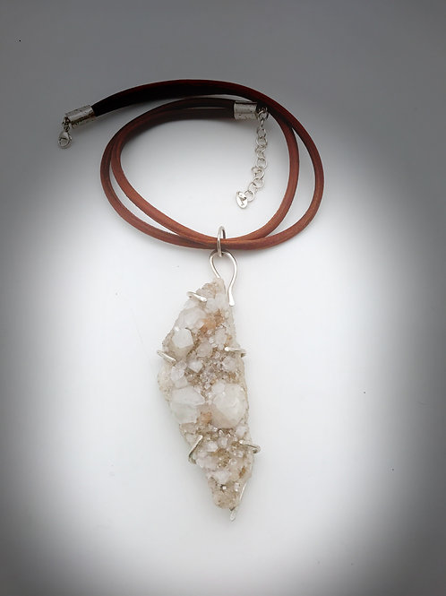 Large apophylite set in Sterling silver on a double leather cord