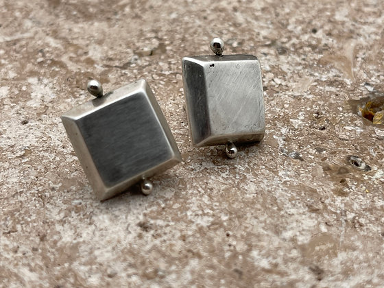 hollow 3 dimensional square bead post style earrings. Come with plastic disk to stabilize earrings  on earlobe