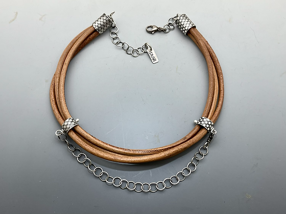 triple strand of round brown leather with handmade sterling endocarps and sterling chain.