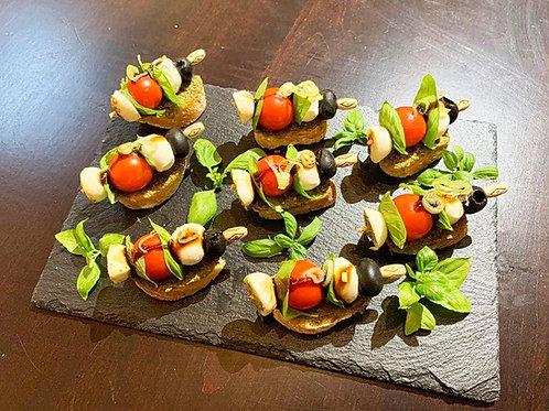 Mozzarella/Tomaten/Basilikumspießchen