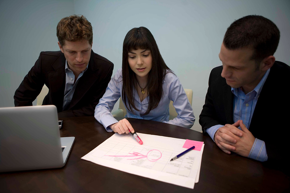 Three business people having a meeting
