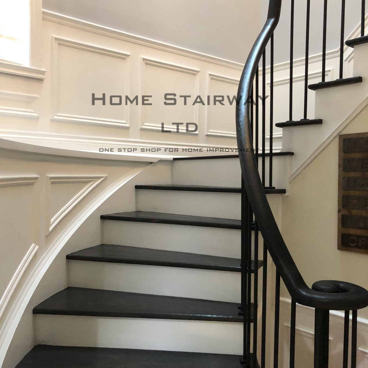 Stairs refacing job done by Home Stairway. Simple plain iron picket. Elegant