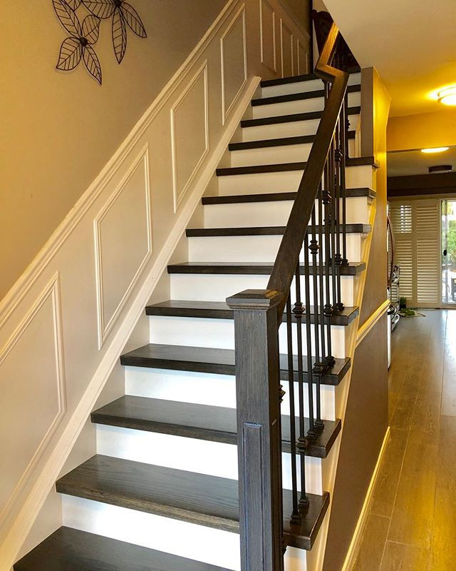 Piano style staircase with wrought iron picket & custom stain with ow leisure varnish | Home Stairway
