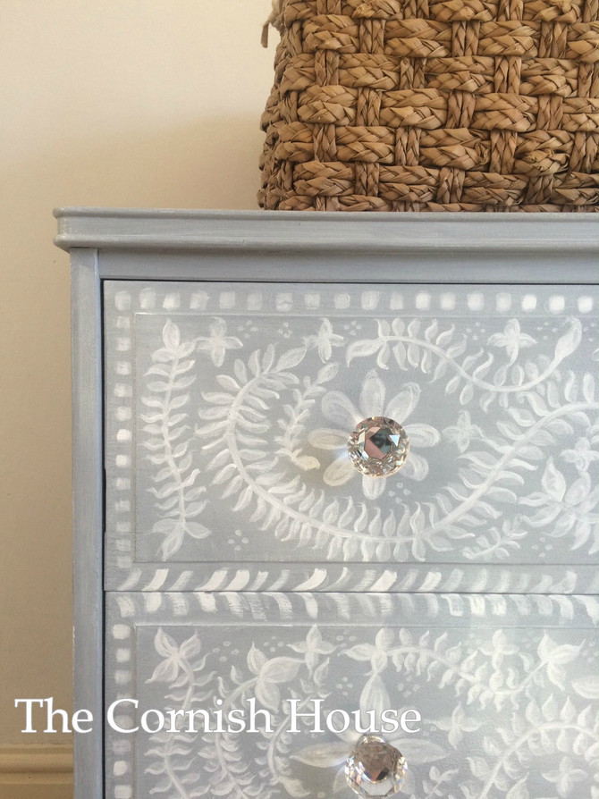 Sunshine inspired freehand mural chest of drawers