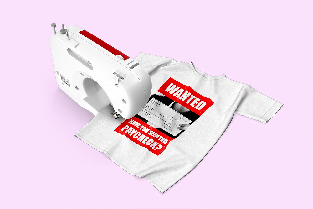 t-shirt with fair trade print being made with a sewing machine on a pink background
