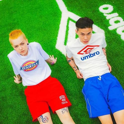 Umbro 2 Colour Logo Tee on football pitch