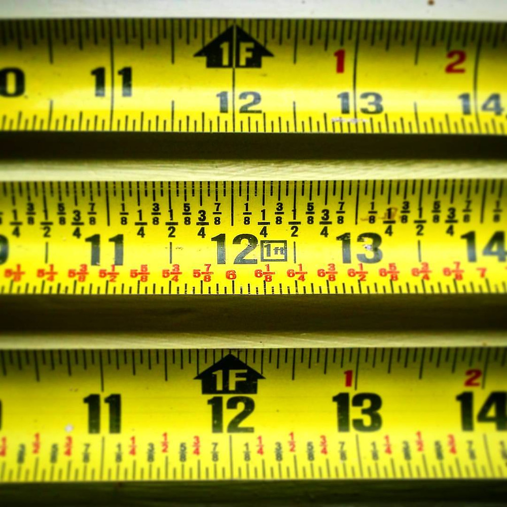 Up top is the normal, everyday measuring tape I grew up with.  The one on the bottom ads fractions.  The one in the middle actually does division for you.  Did you know that twelve divided in half is six?