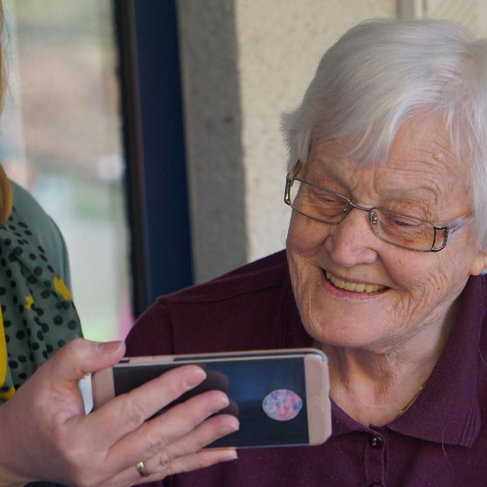 elderly woman using a smart phone