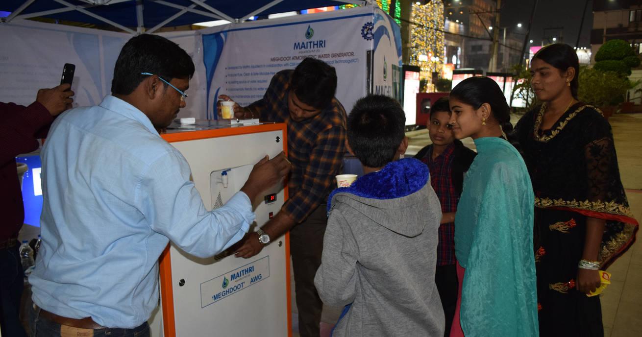 MEGHDOOT providing water to curious onlookers during a demo at PVP Mall, Vijayawada, Andhra Pradesh, India