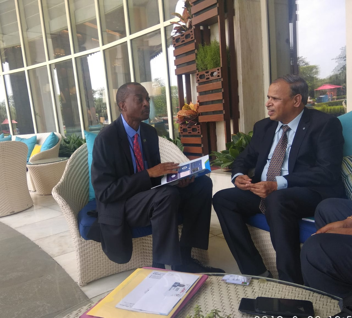 Maithri Aquatech's Managing Director, Mr. M. Ramkrishna with his Excellency, the Deputy High Commissioner of Zambia, Mr. H. Sikapale Chinzewe, discussing water availability and about the MEGHDOOT Atmospheric Water Generator.