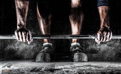 Lifting barbell with chalk