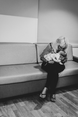 This is a picture of a grandmother holding her new baby granddaughter for the first time at St. Elizabeth Hospital in Lincoln NE