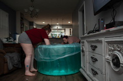 This is a photo of two women setting up a labor pool during a home birth in Lincoln NE