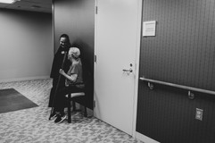 This is a picture of a mother and grandmother of a woman giving birth at St. Elizabeth Hospital in Lincoln NE.  They are chatting in the hallway waiting for the end of a procedure.
