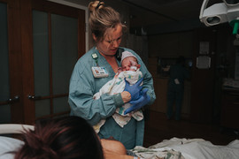 This is a picture of a nurse holding a newborn getting ready to do her measurements at St. Elizabeth Hospital in Lincoln NE