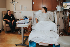 This is a picture of a mom smiling at her daughter as her daughter breathes through a contraction during labor at St. Elizabeth Hospital in Lincoln NE