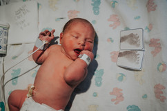 This is a newborn baby girl pictured with her footprints at St. Elizabeth Hospital in Lincoln NE