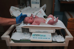 This is a picture of a newborn baby girl being weighed at St. Elizabeth Hospital in Lincoln NE