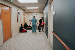 This is a picture of a nurse at St. Elizabeth Hospital in Lincoln NE talking with the family of a woman in labor about her status