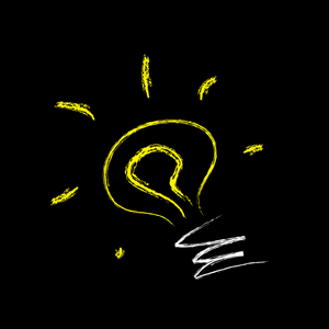 A picture of a light bulb drawn onto a black board