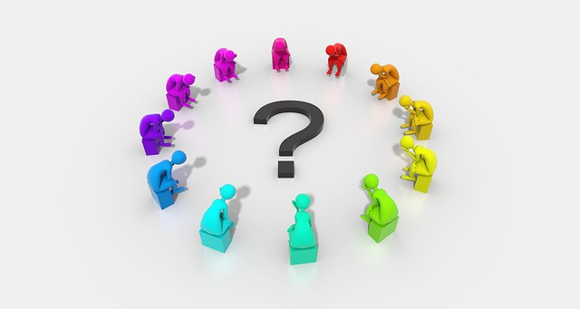 A picture of a question mark and rainbow coloured figures surrounding it in a circle
