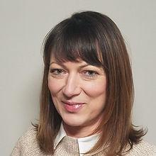 Corina Adelman.jpg