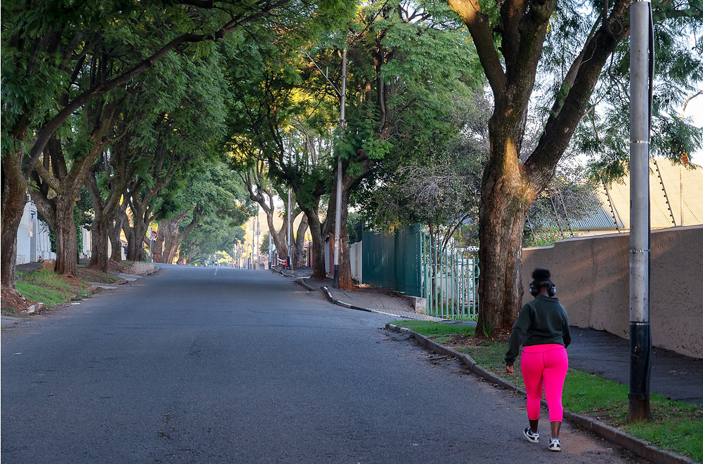 Woman walking in pink pants