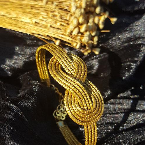 Bracelet tissé forme infini