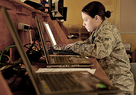 Female soldier at computer.png