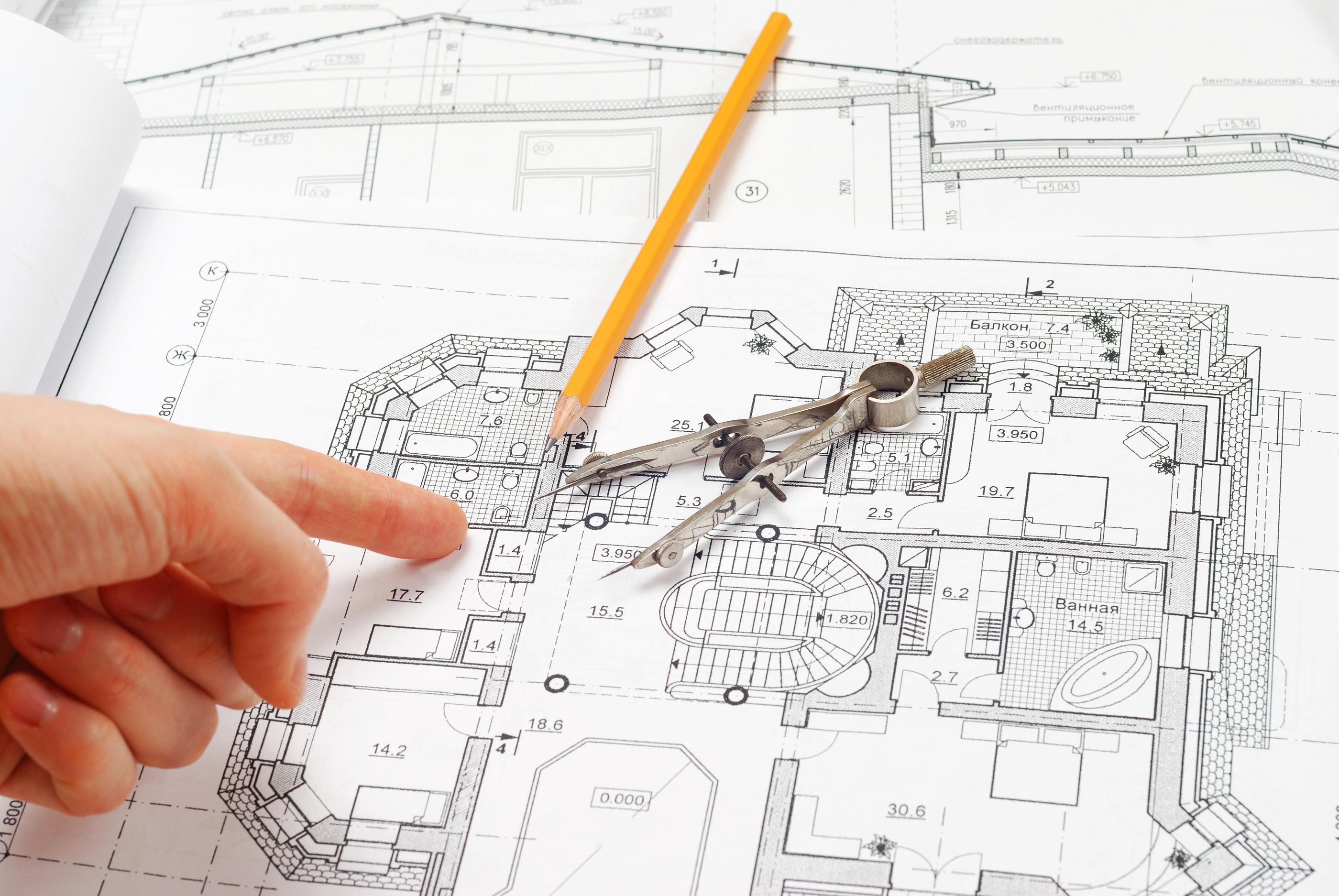 House plan blueprints, designer's hand