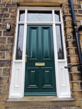 Hardwood door with stained-glass sidelig