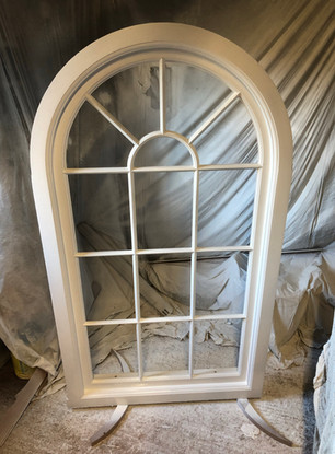 Handcrafted arched window