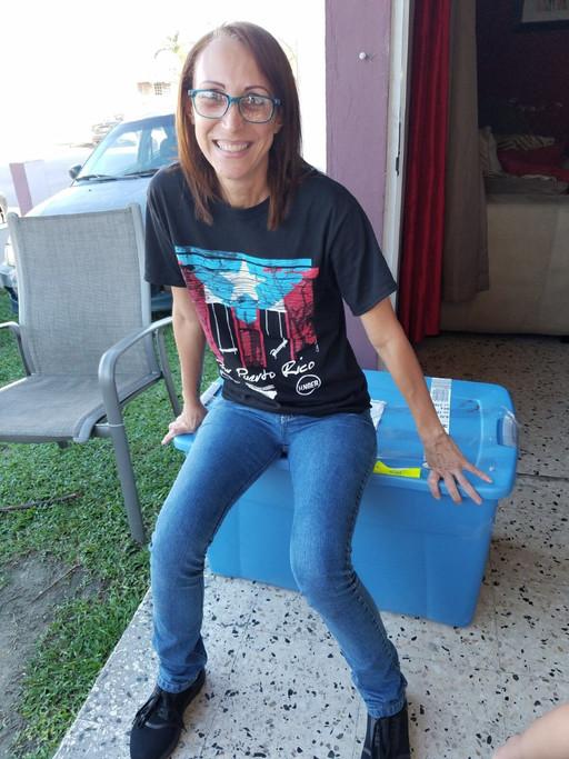 Deborah with he bin of supplies- Yabucoa Resident