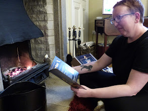Sarah sitting in front of the fire reading all about Box42 Dates