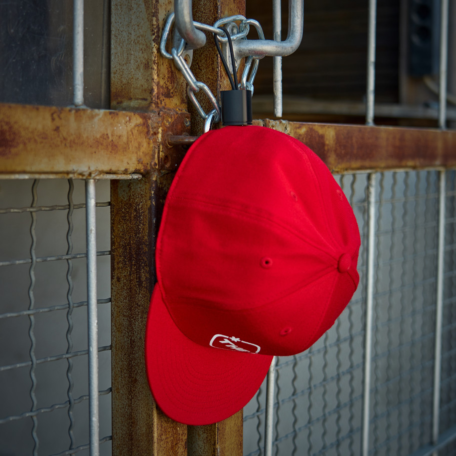 snapback on a magnetic cap holder by the hat pal.