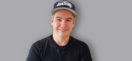 David Lopez founder and ceo of the hat pal wearing a fitted seahawks dark blue cap. Founder of the magnetic cap holder, and wall mounted cap hanger.