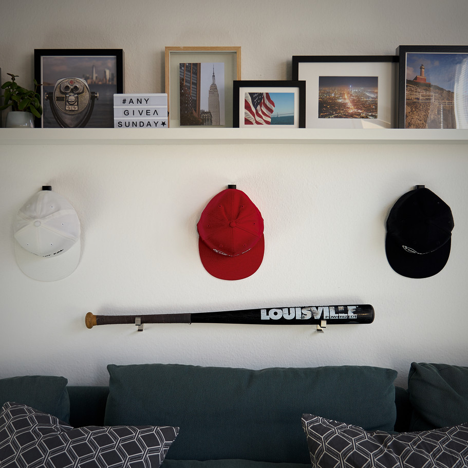 snapback on wall mounted cap hanger by thehatpal. the company for cap collectors and cap addicts.
