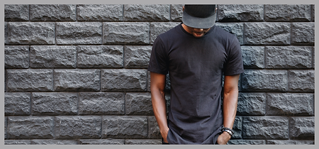 Man wearing a black snapback.Using the companion, mobile magnetic hat holder, the hat pal.