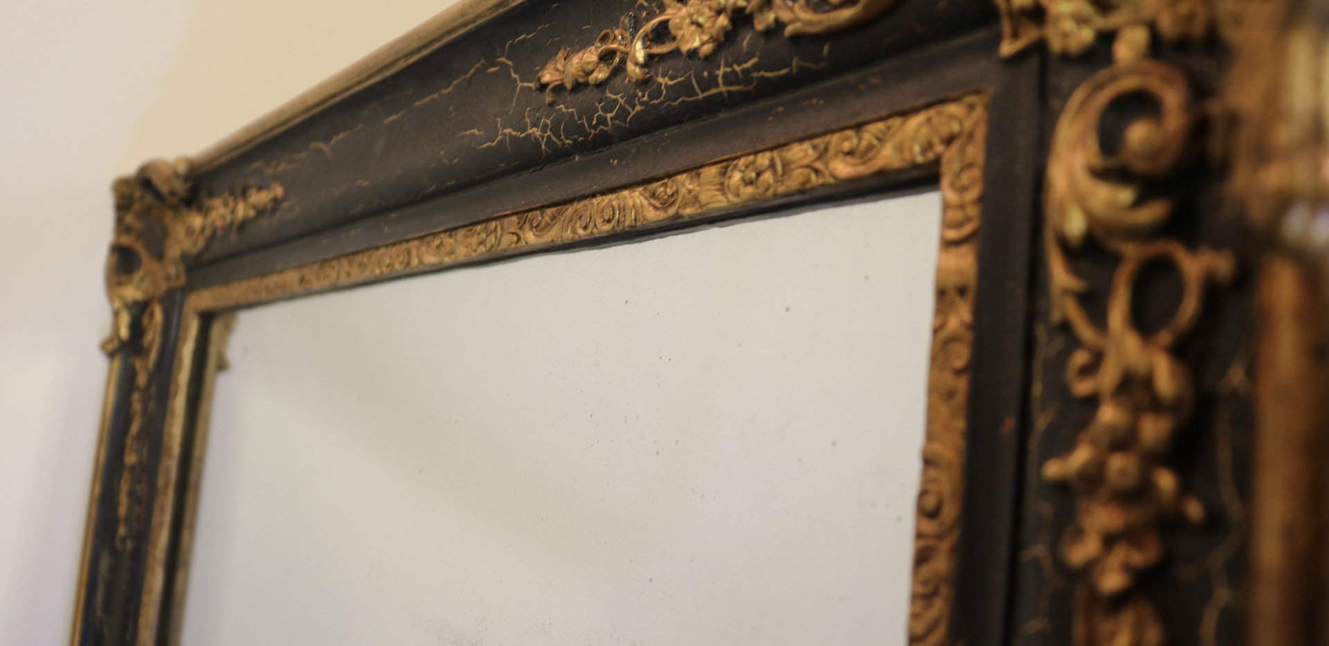 Ebonised and gilt Mirror