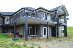 back view of grey house with dark trim-2