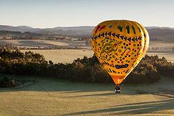 hot-air-balloon-at-sunrise-TAUF7WD.jpg
