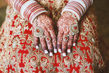 indian-bride-holds-her-hands-with-lots-of-bracelet-2021-04-06-19-56-07-utc.jpg