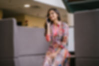 photo-of-smiling-woman-in-floral-salwar-